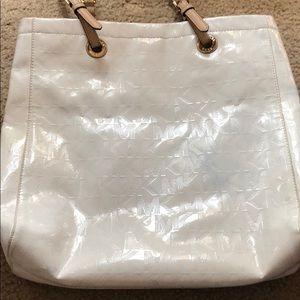 Very white Michael Kos shiny bag 💼